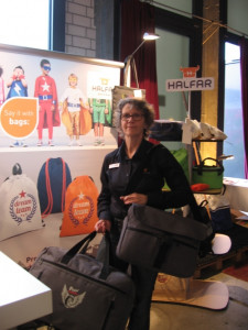 Petra Siekmann, Teamleader export at Halfar System GmbH shows the new 1814010 Fashion notebook bag and 1814017 Fashion travel bag