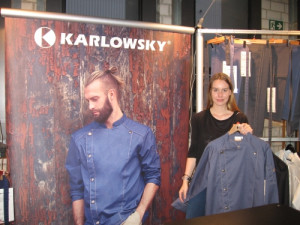 Josie Reutes, Marketing coordinator at Karlowsky Fashion GmbH shows the new Chef Jacket Jeans 1892 Tennessee